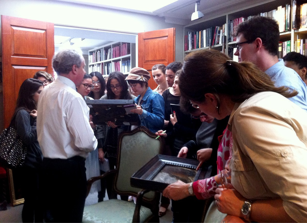 Art & its Markets: students taking a closer look at some oil paintings with the Head of Research, at Colnaghi