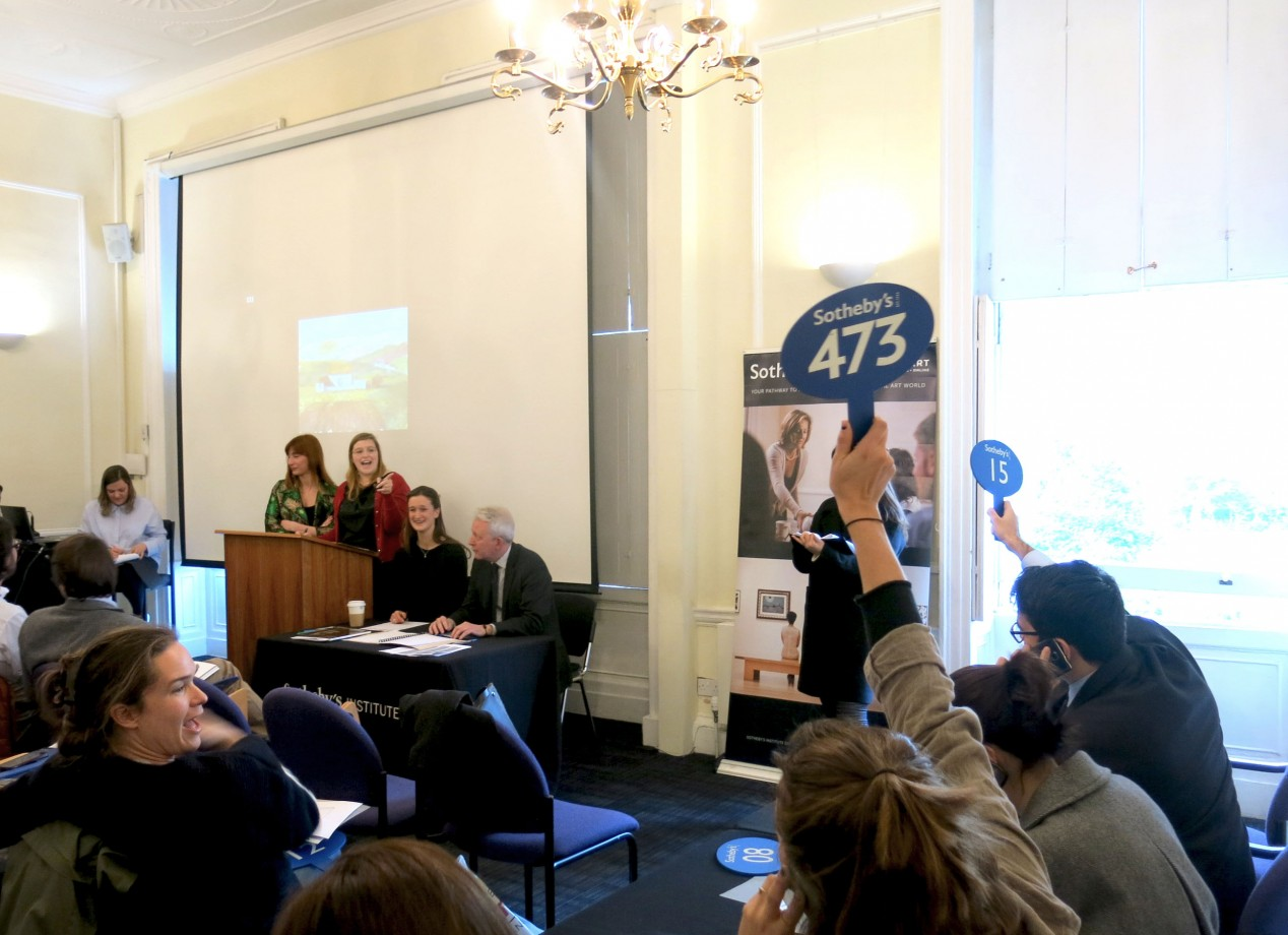 Art and Business students taking part in a mock auction with the help of Sotheby's staff >