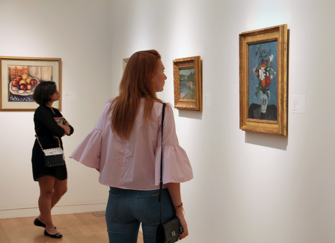 7. Students enjoy an auction house viewing of works in an upcoming sale.